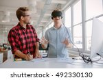 shot of two young men testing... | Shutterstock . vector #492330130