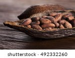 cocoa pod on wooden table | Shutterstock . vector #492332260