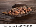 cocoa pod on wooden background | Shutterstock . vector #492339358