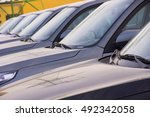 a row of new cars parked at a... | Shutterstock . vector #492342058