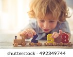 cute little boy is playing with ... | Shutterstock . vector #492349744