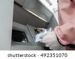 man standing in front of an atm ... | Shutterstock . vector #492351070