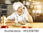 young cook in kitchen and food... | Shutterstock . vector #492358780