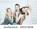 three female friends posing in... | Shutterstock . vector #492373858