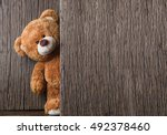 Cute Teddy Bear On Old Wood...