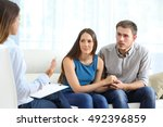 worried couple listening to... | Shutterstock . vector #492396859