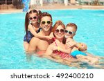happy family in swimming pool... | Shutterstock . vector #492400210