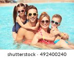happy family in swimming pool... | Shutterstock . vector #492400240