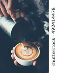 cup of coffee latte art make by ... | Shutterstock . vector #492414478