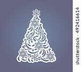 christmas tree cut out of paper.... | Shutterstock .eps vector #492416614