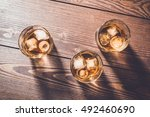 glasses of whiskey on an old...   Shutterstock . vector #492460690