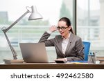businesswoman working at her... | Shutterstock . vector #492462580