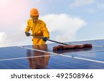 employee man cleaning of solar... | Shutterstock . vector #492508966