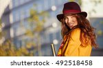 woman in autumn city | Shutterstock . vector #492518458