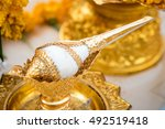 Small photo of Conch shell adorned with gold use for Pour water In various events