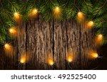 christmas light with fir... | Shutterstock .eps vector #492525400
