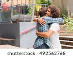 cheerful best friends embracing ... | Shutterstock . vector #492562768