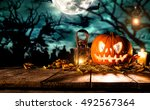 scary halloween pumpkin on... | Shutterstock . vector #492567364
