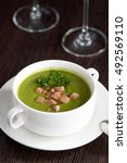 Small photo of green soup with mea andt parsley