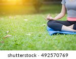yoga in the park  outdoor with... | Shutterstock . vector #492570769