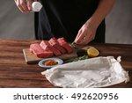 butcher cooking pork meat on... | Shutterstock . vector #492620956