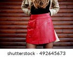 woman wearing red leather skirt.... | Shutterstock . vector #492645673