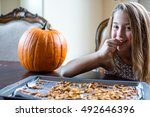 young girl eating fresh baked... | Shutterstock . vector #492646396