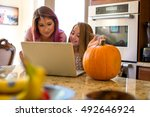 mother and daughter researching ... | Shutterstock . vector #492646924
