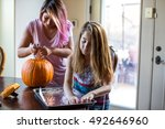 mother and daughter carving a... | Shutterstock . vector #492646960