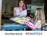 mother and daughter putting... | Shutterstock . vector #492647014