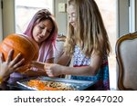 mother and daughter carving a... | Shutterstock . vector #492647020