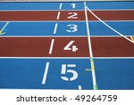 Starting numbers on an athletic track - stock photo
