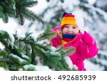 Child Playing In Snowy Forest....