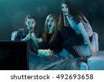 teenage girls watching horror... | Shutterstock . vector #492693658