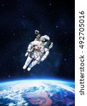 astronaut in outer space over...   Shutterstock . vector #492705016