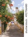street with flowers in obidos ... | Shutterstock . vector #492706480