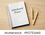 workout plan on notebook on desk   Shutterstock . vector #492751660
