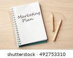 marketing plan on notebook on... | Shutterstock . vector #492753310