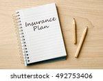 insurance plan on notebook on... | Shutterstock . vector #492753406