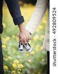 future parents holding hands... | Shutterstock . vector #492809524