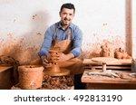 happy european artisan man...   Shutterstock . vector #492813190