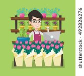 young smiling florist using... | Shutterstock .eps vector #492826276