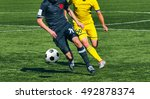 soccer player legs in action  | Shutterstock . vector #492878374
