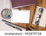 top view of wooden desktop with ... | Shutterstock . vector #492879718