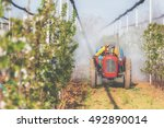 Tractor Spraying On A Cherry...