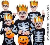 little boy in costume skeletons.... | Shutterstock . vector #492897298