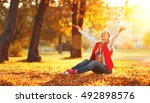 a happy young woman resting... | Shutterstock . vector #492898576