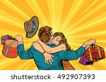 Wife Hugs Her Husband With...