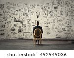 businessman trying to solve... | Shutterstock . vector #492949036