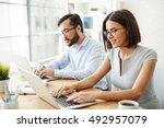 successful office workers | Shutterstock . vector #492957079